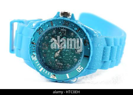 wet blue wristwatch isolated on white background - Stock Photo