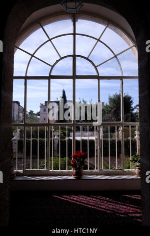 View through an arched window of the American Colony Hotel in East Jerusalem Israel - Stock Photo