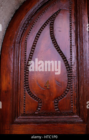 A carved wooden door of room number 4 in the American Colony Hotel in East Jerusalem Israel - Stock Photo