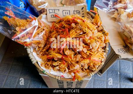 Dried seafood on sale in in the Tai O fishing village, Lantau Island, Hong Kong, China. - Stock Photo