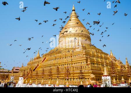 Shwezigon Pagoda (or Shwezigon Paya), a Burmese stupa built in the 11-12th centuries, Nyaung-U, Myanmar. - Stock Photo