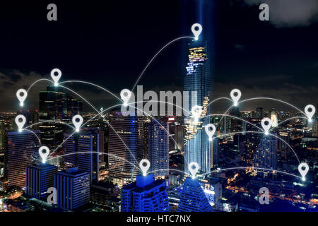 Map pin at smart city and wireless communication network, business district with office building, abstract image - Stock Photo