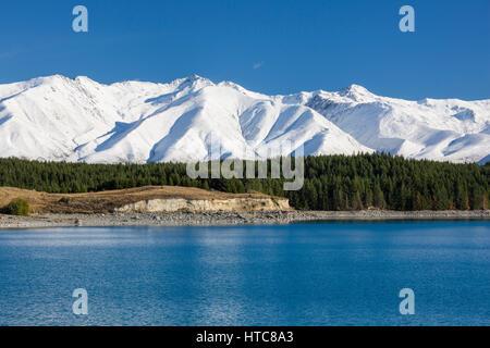 Twizel, Canterbury, New Zealand. View across Lake Pukaki to the snow-covered peaks of the Ben Ohau Range, autumn.