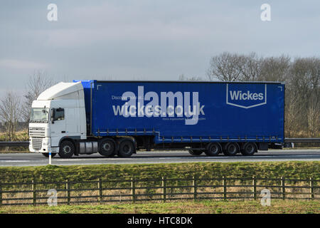 Distribution & transportation - an articulated lorry, heavy goods vehicle (HGV) with Wickes logo travelling on the - Stock Photo