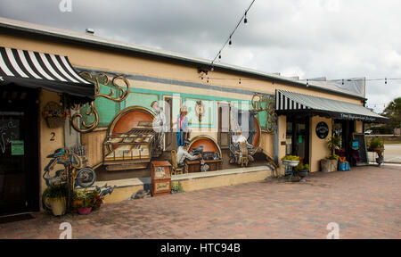 Art murals painted on outdoor building walls in Lake Placid Florida known as the Town of Murals - Stock Photo
