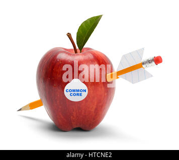 Apple with Common Core Sticker Shot by Pencil Arrow Isolated on White. - Stock Photo