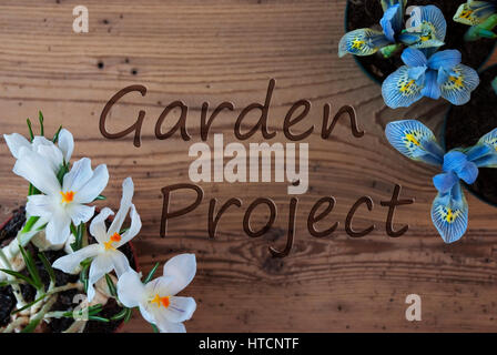 Wooden Background With English Text Garden Project. Spring Flowers Like Grape Hyacinth And Crocus. Aged Or Vintage - Stock Photo