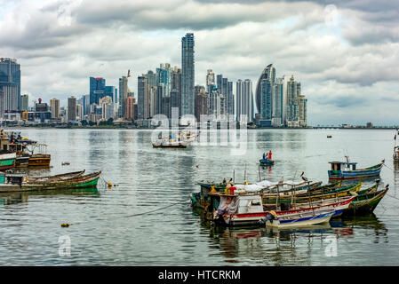 Commercial fishing boats with the Panama City area of Punta Paitilla skyline in the background; Panama city, Panama - Stock Photo