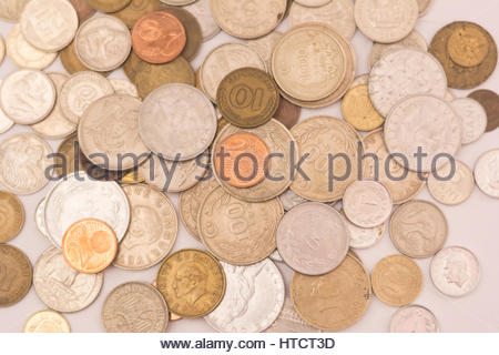 old turkish liras and foreign coins on isolated white texture - Stock Photo
