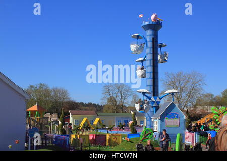 ROMSEY, HAMPSHIRE, ENGLAND, 14 JUN 2016: Visitors and rides at the Peppa Pig World attraction - Stock Photo