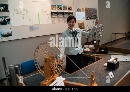 Cotton spinning demonstration at the Toyota Commemorative Museum of Industry and Technology. Kawai-san demonstrates - Stock Photo