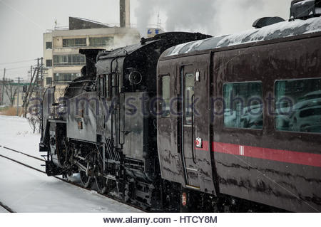 Japanese steam special in Hokkaido winter with a Class C11 tank locomotive at Kushiro station - Stock Photo