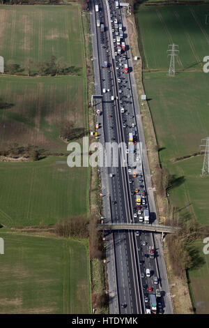 aerial view of heavy traffic on the M6 in Cheshire, UK - Stock Photo