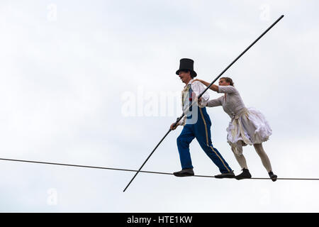 Bullzini Family present Equilibrius feats on highwire at Up in the Air at Harbourside, Baiter Park, Poole in September - Stock Photo