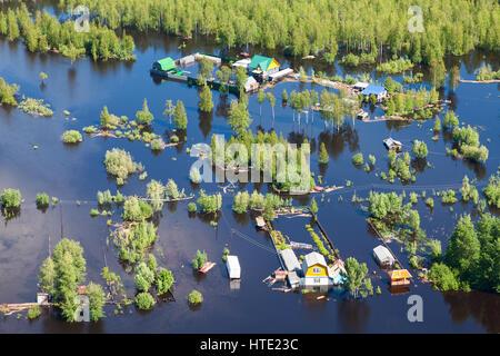 Ob River Flood June 2015 Aerial View of same houses in vicinity of Nizhnevartovsk, Tyumen region, Russia. Aerial - Stock Photo