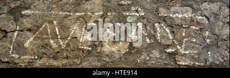 Roman Era. High Empire. Fragment of pavement with welcome inscription. Fragment of a pavement of Opus Signinum with - Stock Photo