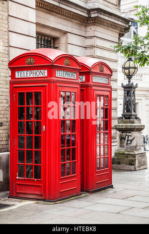 A row of red telephone boxes in London. - Stock Photo