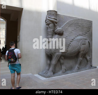 Lamassu from the Palace of Sargon II. Assyrians. 721-705 BC. Khorsabad Palace. Louvre Museum. Paris. France. - Stock Photo