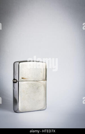 Metal lighter on paper background - Stock Photo