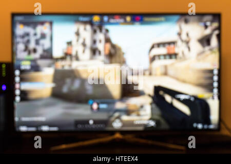Counter-strike professional game on tv and remote control - Stock Photo