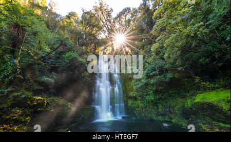 McLean waterfall, Sun Star, The Catlins, Otago, Southland, New Zealand - Stock Photo