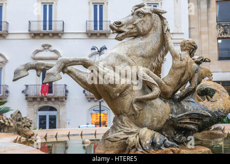 Artemis Fountain (also called Diana Fountain) on Archimedes Square (Piazza Archimede) on Ortygia island, historical - Stock Photo