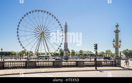 France, Paris, Place de la Concorde, Grand Carousel Feries Wheel and the Obelisk of Luxor - Stock Photo