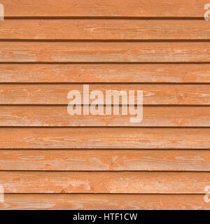 Natural old wood fence planks, wooden close board texture, overlapping bright reddish brown closeboard terracotta - Stock Photo