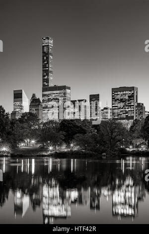 Midtown skyscrapers reflecting upon the Central Park lake at twilight. Black & White. Manhattan, New York City - Stock Photo