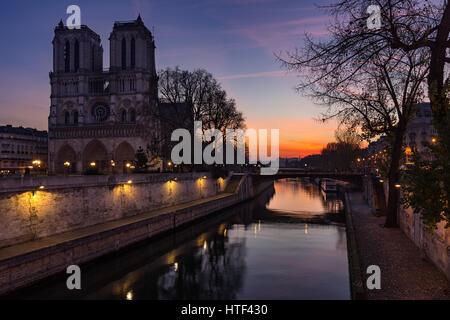 Notre Dame de Paris cathedral at sunrise with the Seine River. Ile de La Cite. 4th Arrondissement, Paris, France Stock Photo