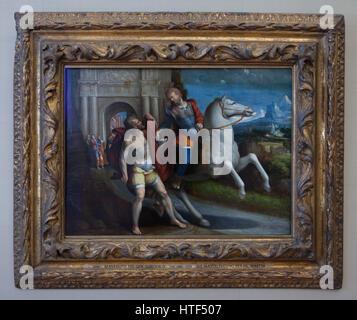 Painting Saint Martin sharing his coat with a beggar by Italian Mannerist painter Benvenuto Tisi (Garofalo) on display - Stock Photo