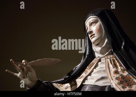 Saint Teresa of Avila. Polychrome wooden statue by Spanish Baroque sculptor Gregorio Fernandez (1625) on display - Stock Photo