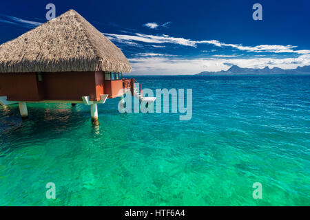 Overwater bungalows with best beach for snorkeling, Tahiti, French Polynesia - Stock Photo