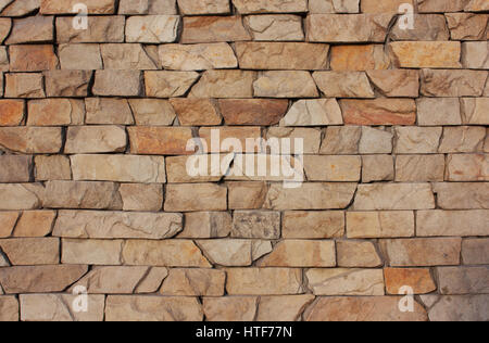 The old brick background. Medieval, antique textured wall fence. Stone in a row - Stock Photo