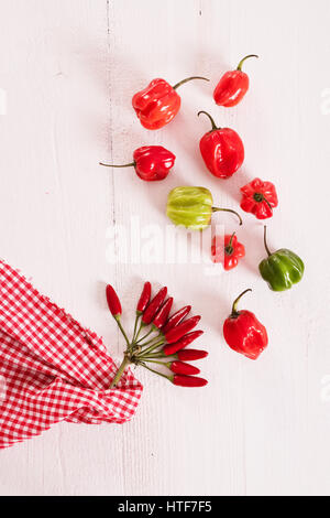 Red hot chili peppers on wooden table. - Stock Photo