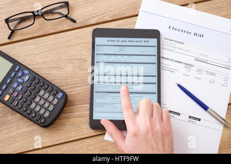 Electric bill charges form for online payment - Stock Photo