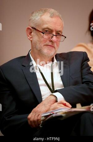Leader of the Labour Party Jeremy Corbyn listens as Shadow Chancellor John McDonnell speaks at the Labour Economic - Stock Photo