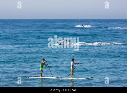 Marbella, Costa del Sol, Malaga Province, Andalusia, southern Spain. Group practicing standup paddle boarding. - Stock Photo