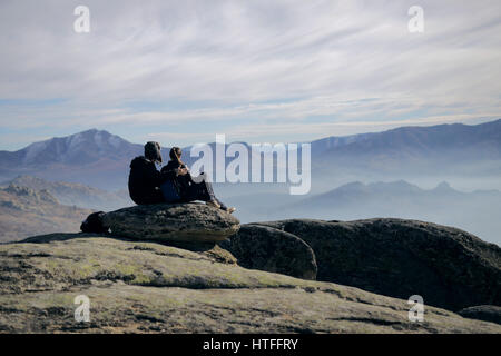Couple enjoy in the view on mountain and out of city smog - Stock Photo