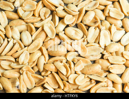 Peanuts. Close up of fried, peeled and salted peanuts. - Stock Photo