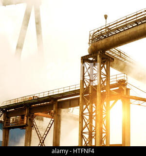 Steel mill crane, smoke-filled air pollution. - Stock Photo
