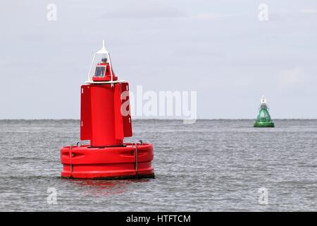 lateral buoys at the edge of a fairway - Stock Photo