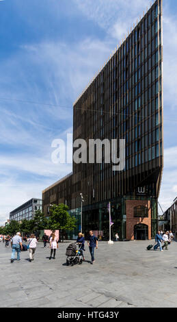 People walking on sunny day past Waterstones building in Liverpool England - Stock Photo