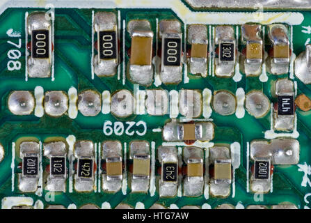 Surface-mount components on printed circuit board - Stock Photo