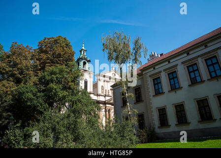 The Church of Saint Anne on the edge of Planty Park in Krakow Poland - Stock Photo