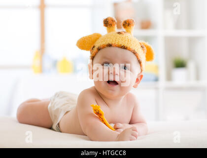 happy infant baby child in giraffe costume - Stock Photo