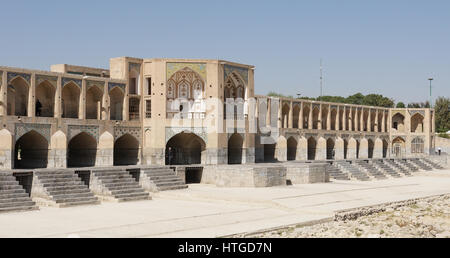 ISFAHAN, IRAN - OCTOBER 11, 2016: Khaju bridge crossing parched Zayandehrud river on October 11, 2016 in Isfahan, - Stock Photo