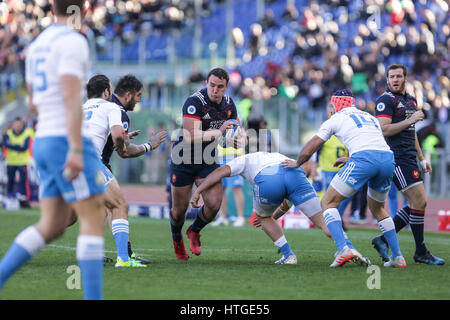Rome, Italy. 11th Mar, 2017. France's n.8 Louis Picamoles resists to a tackle in the rugby match against Italy in - Stock Photo
