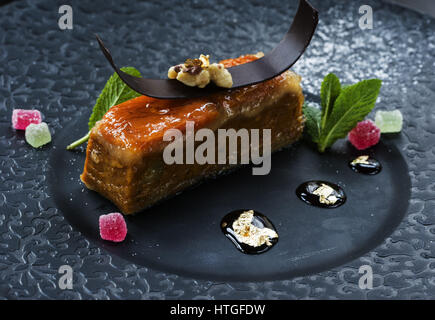Marzipan dessert. 4th Mar, 2017. Marzipan is a confection consisting primarily of sugar or honey and almond meal - Stock Photo