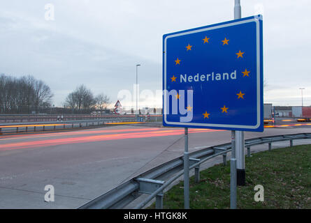 Gildehaus, Germany. 10th Mar, 2017. A sign reads 'Nederland' (Netherlands) seen at the German-Dutch border crossing - Stock Photo